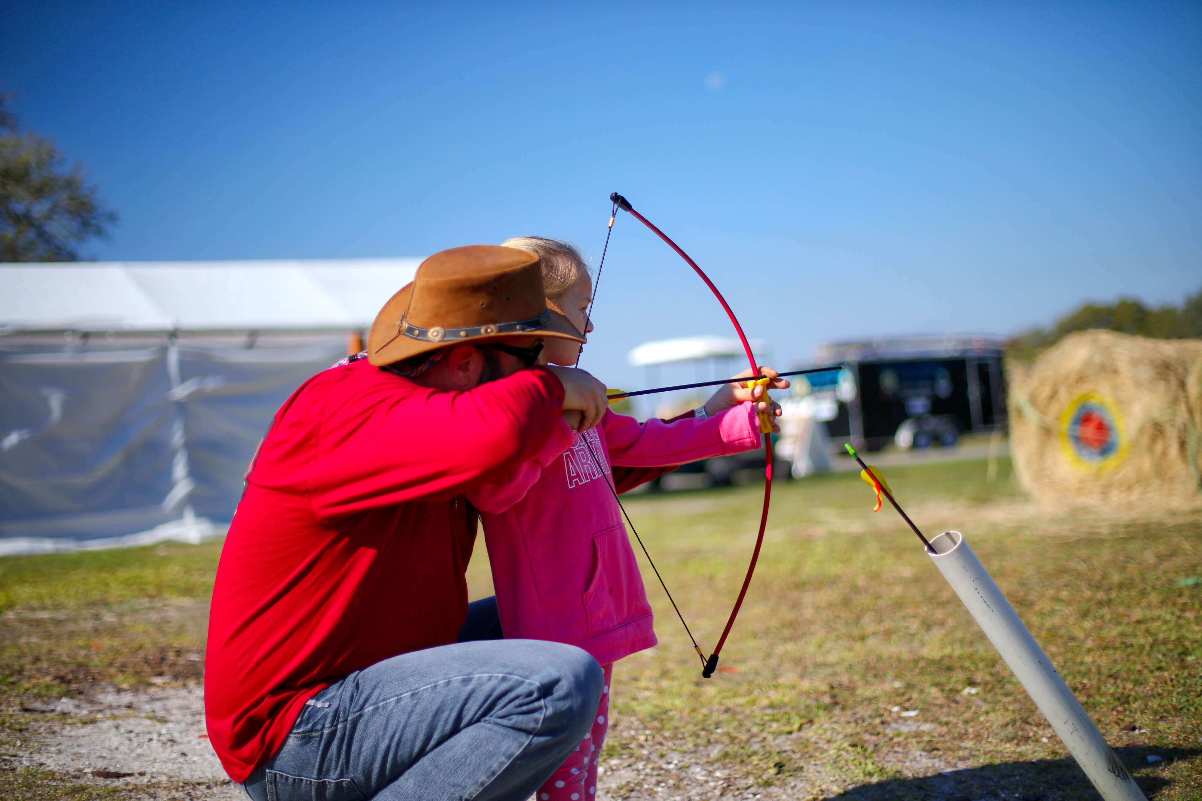Father and daughter at Archery Range | Westgate River Ranch Resort & Rodeo | Westgate Resorts