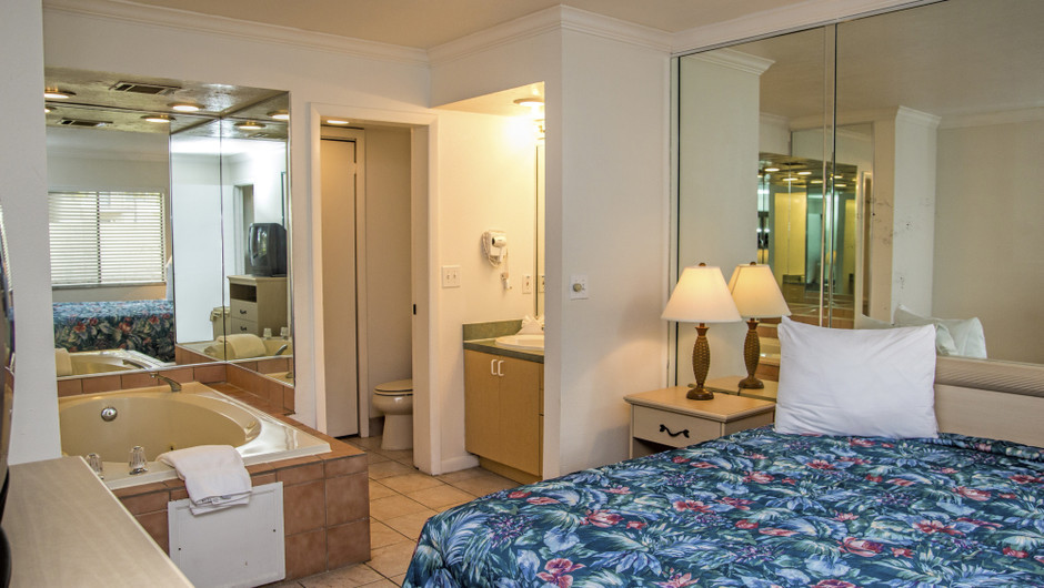 Club Orlando one-bedroom villa view from the king bed with private bathroom and jetted tub | Club Orlando | Westgate Resorts