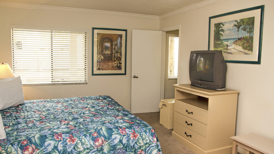 Club Orlando one-bedroom villa view from the king bed looking at the dresser and tv | Club Orlando | Westgate Resorts