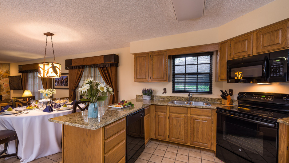 Kitchen in Lodge Two-Bedroom Cottage    Westgate River Ranch Resort & Rodeo   Westgate Resorts