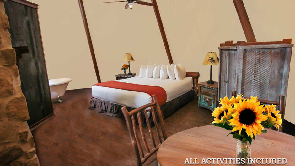 View of Bed in Luxe Teepee for Glamping |  Westgate River Ranch Resort & Rodeo | Westgate Resorts