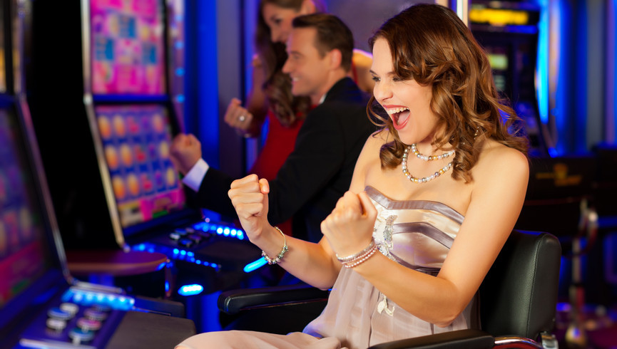 Las Vegas Hotel and Casino with the Best Las Vegas Hotel Deals | Woman at Slot Machine