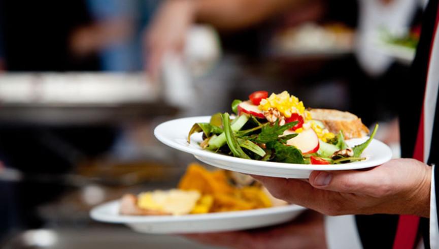 Server Holding Food | Westgate Palace Resort | Orlando, FL | Westgate Resorts