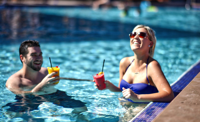 Couple having drinks in the pool | Westgate Palace Resort