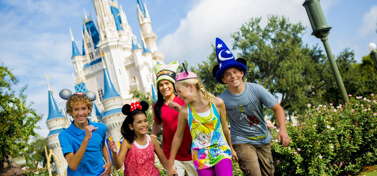 Family in Front of Cinderella's Castle | Westgate Lakes Resort & Spa | Orlando, FL | Westgate Resorts