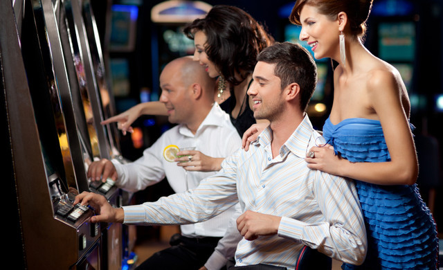 People Enjoying Slot Machines