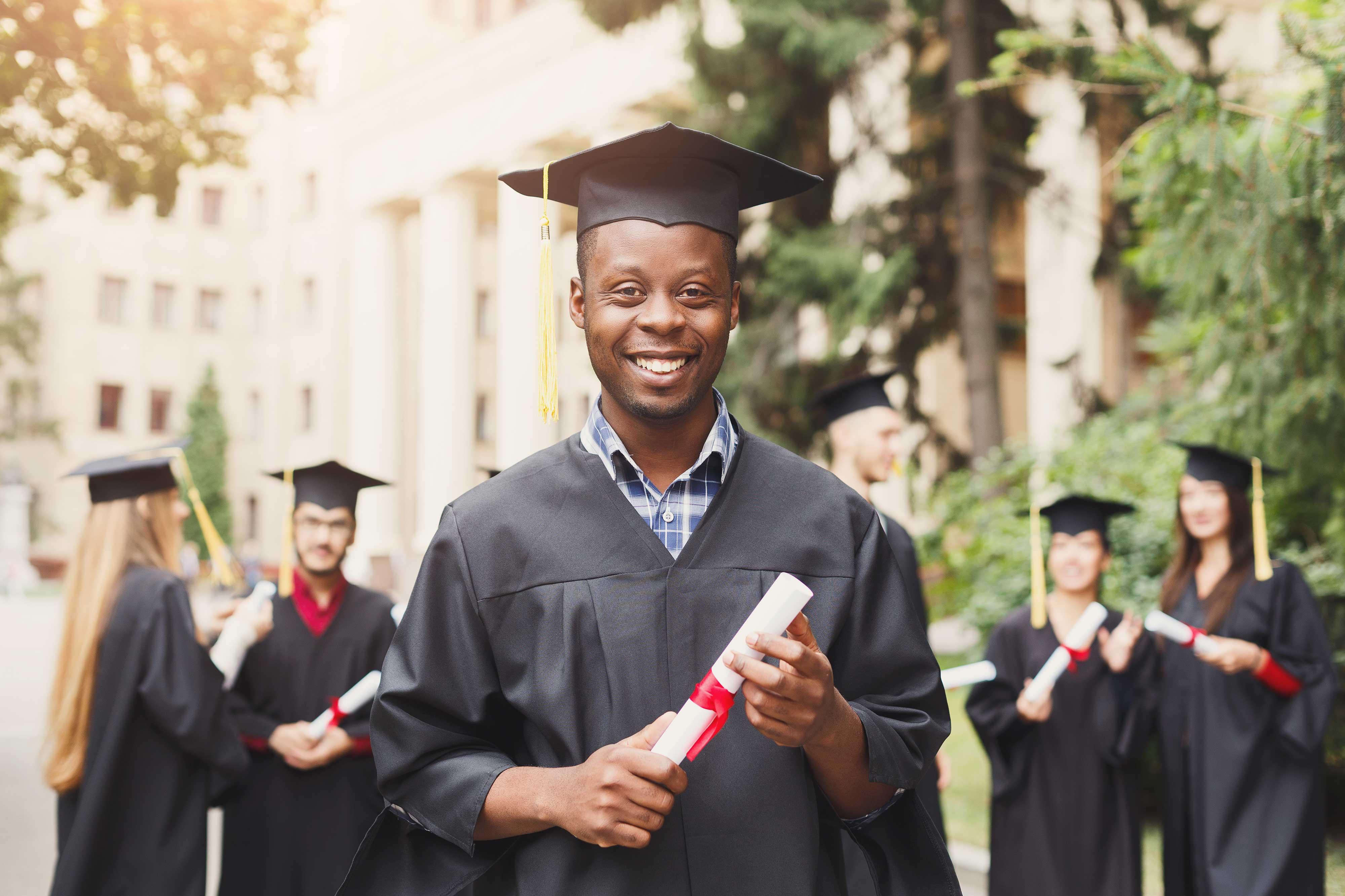 A Rural Retreat For High School Graduation Celebrations   Graduate holding diploma