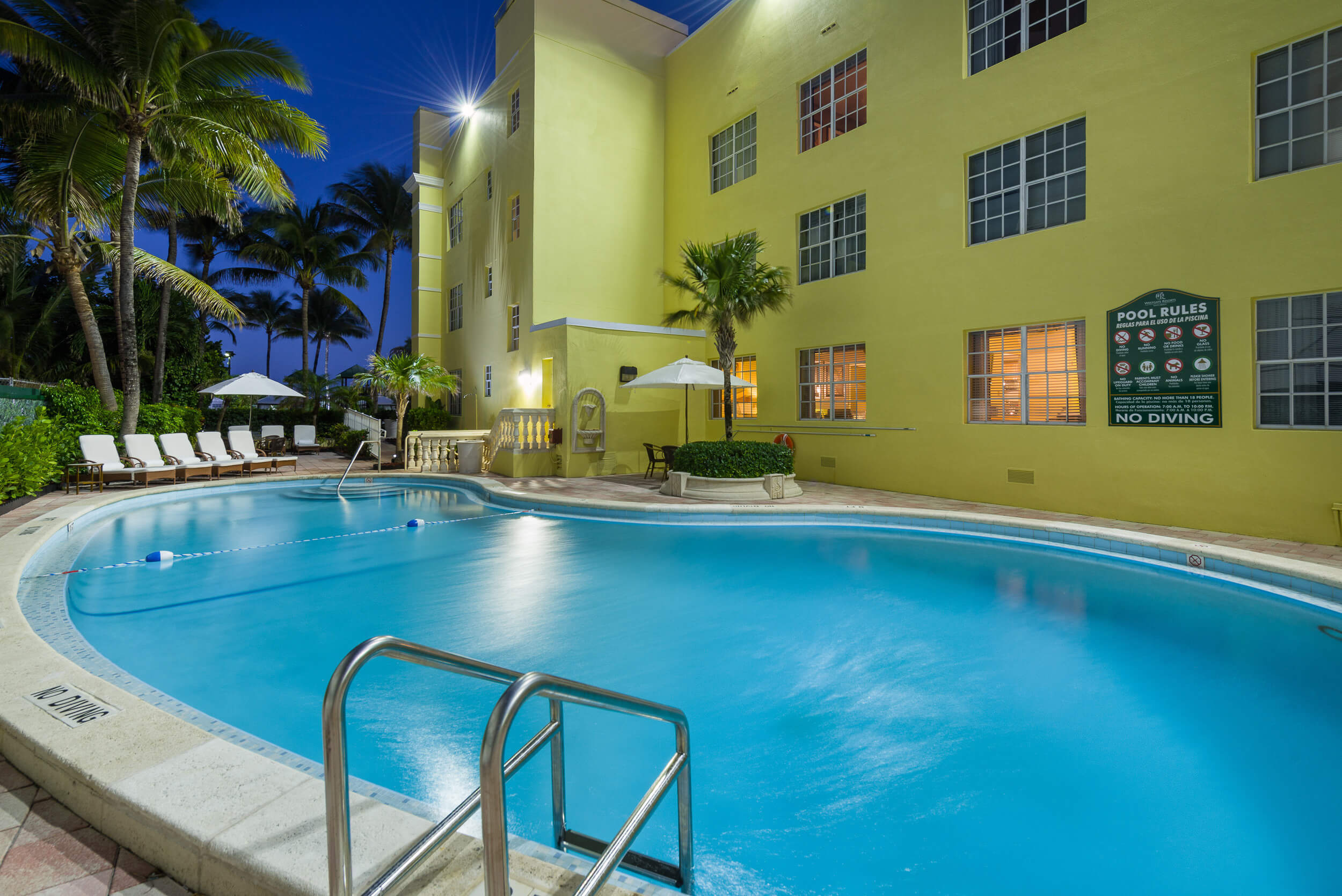 Heated outdoor pool with lounge chairs | Westgate South Beach Oceanfront Resort