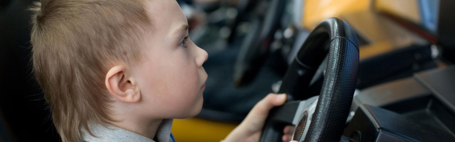 Child having fun at our game room in Orlando Florida | Orlando Resort Game Rooms | Westgate Lakes Resort & Spa