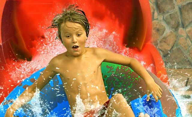 Shipwreck Island Water Park Kissimmee | Kid on Tube Slide