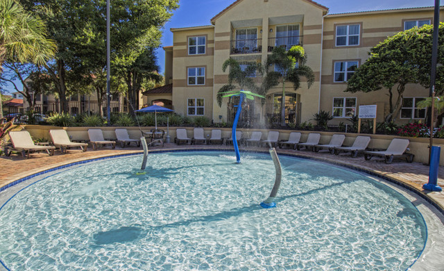 Poolside With Senior Citizen Discounts | Westgate Blue Tree Resort | Hotel Senior Discounts in Florida Near Sea World Area, Orlando, FL 32836