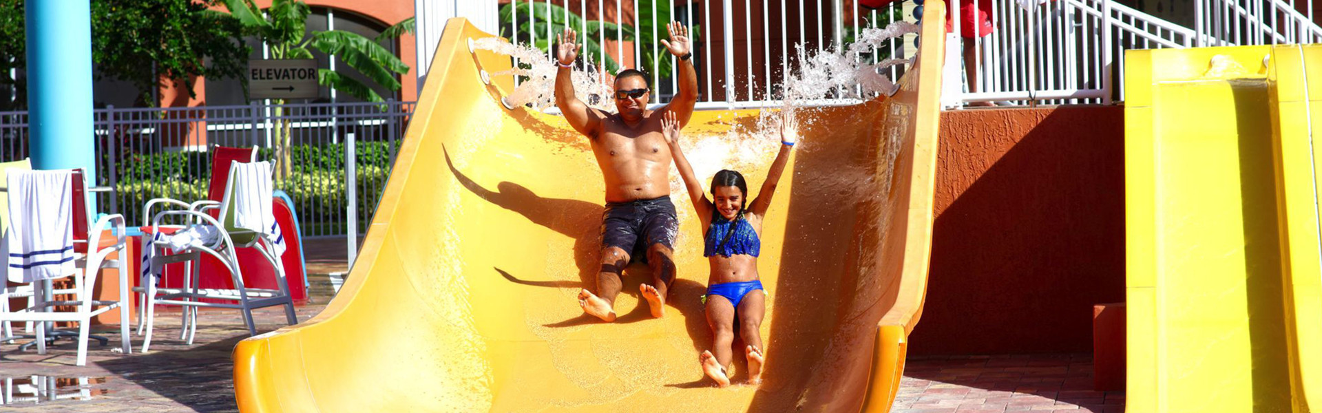 Shipwreck Island Water Park Kissimmee | Family on Waterslide