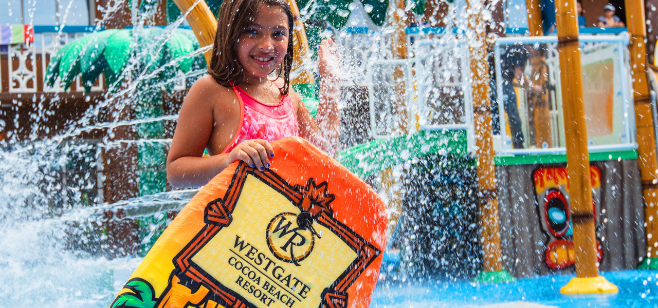Water Parks Resort in Florida at our Hotel near Cocoa Beach | Water Park Girl With Board