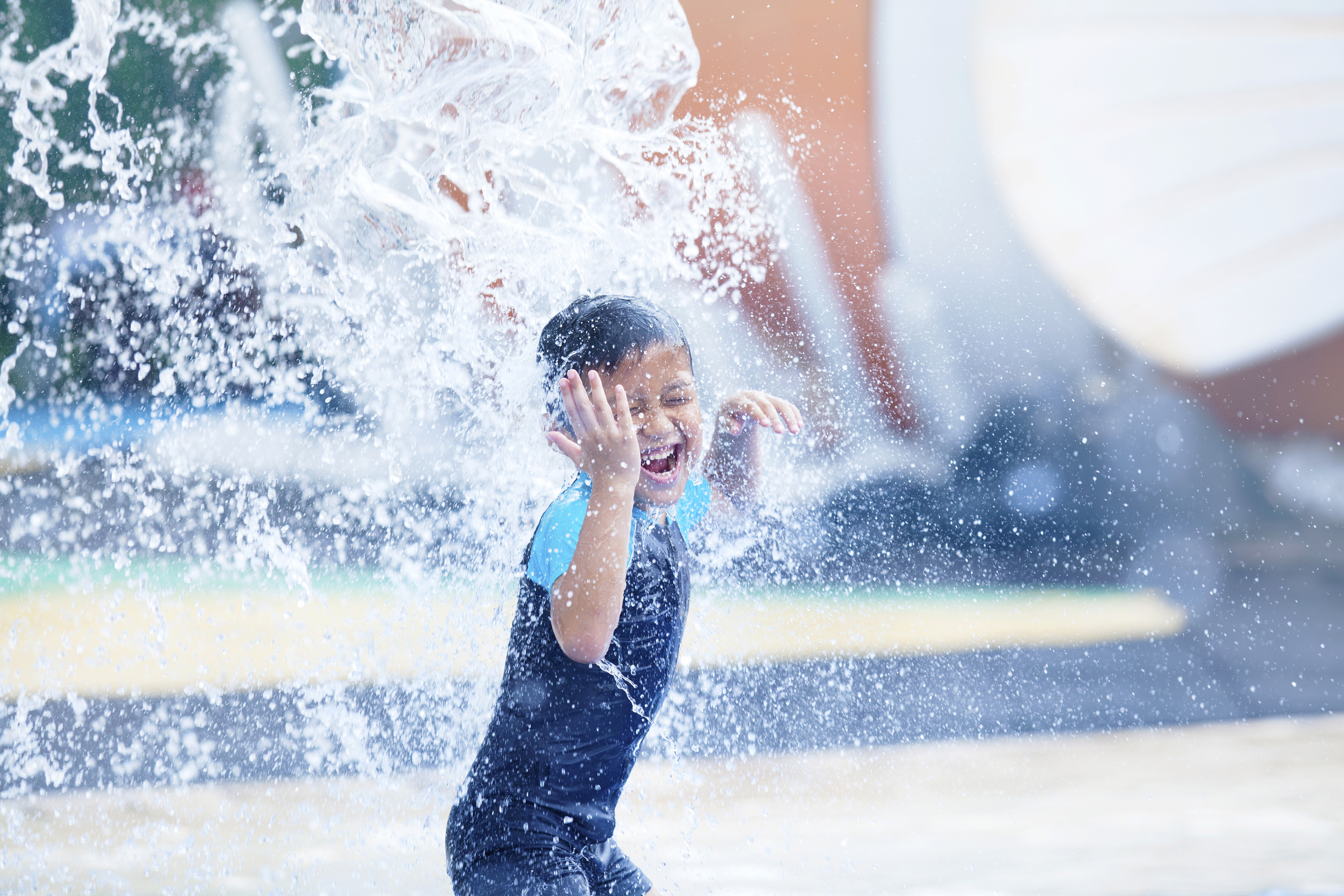 A boy splashing water - Westgate Resorts