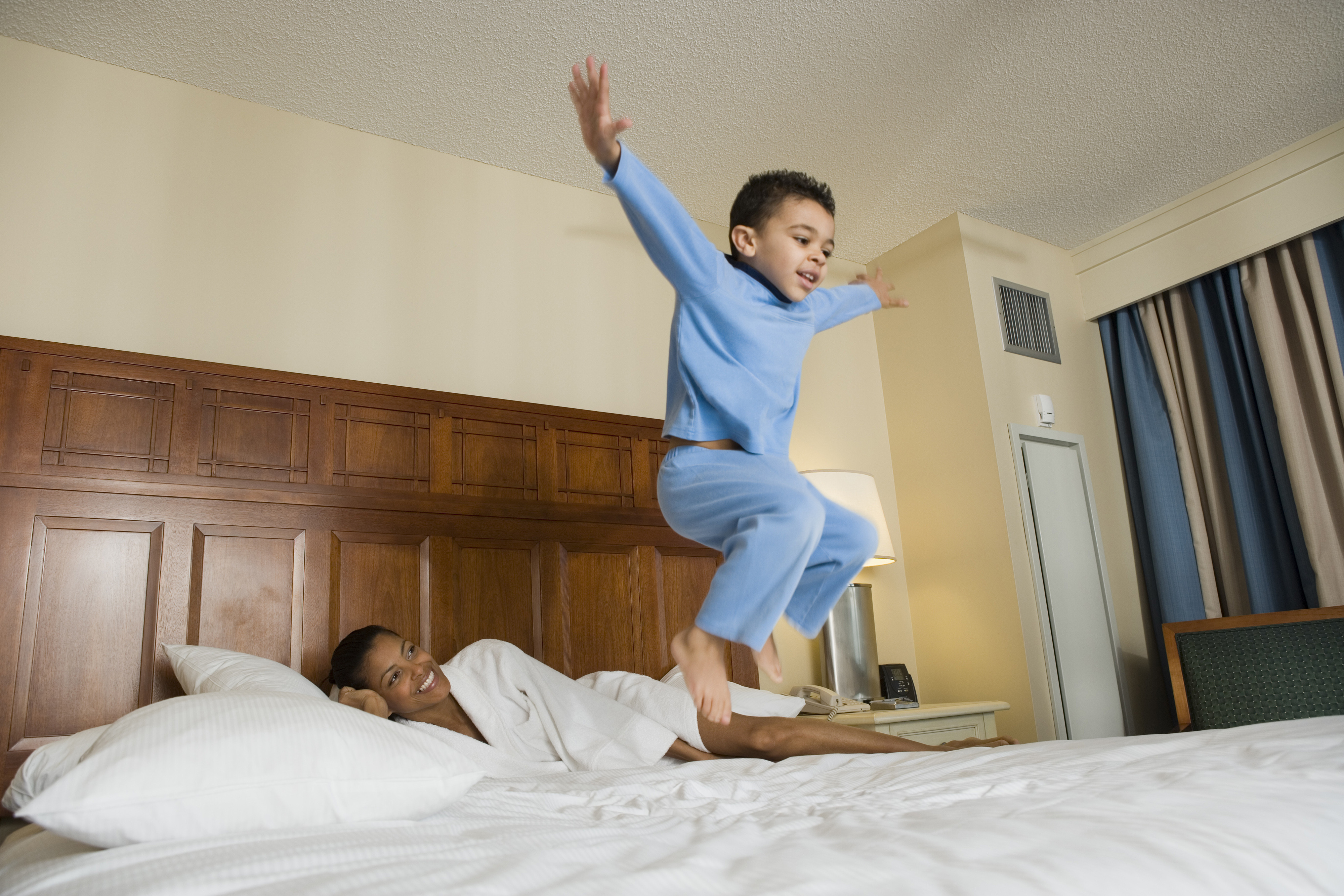 Little boy jumping on bed - Westgate Resorts