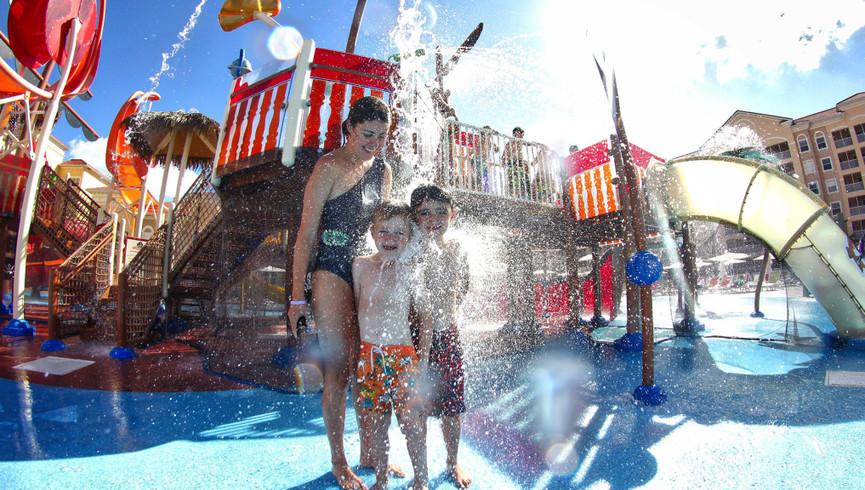 Family Splashing At Shipwreck Island Water Park