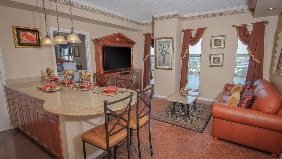 Living Area and Kitchen Bar Seen from Doorway   Two-Bedroom Deluxe Villa   Westgate Palace Resort   Orlando, FL   Westgate Resorts