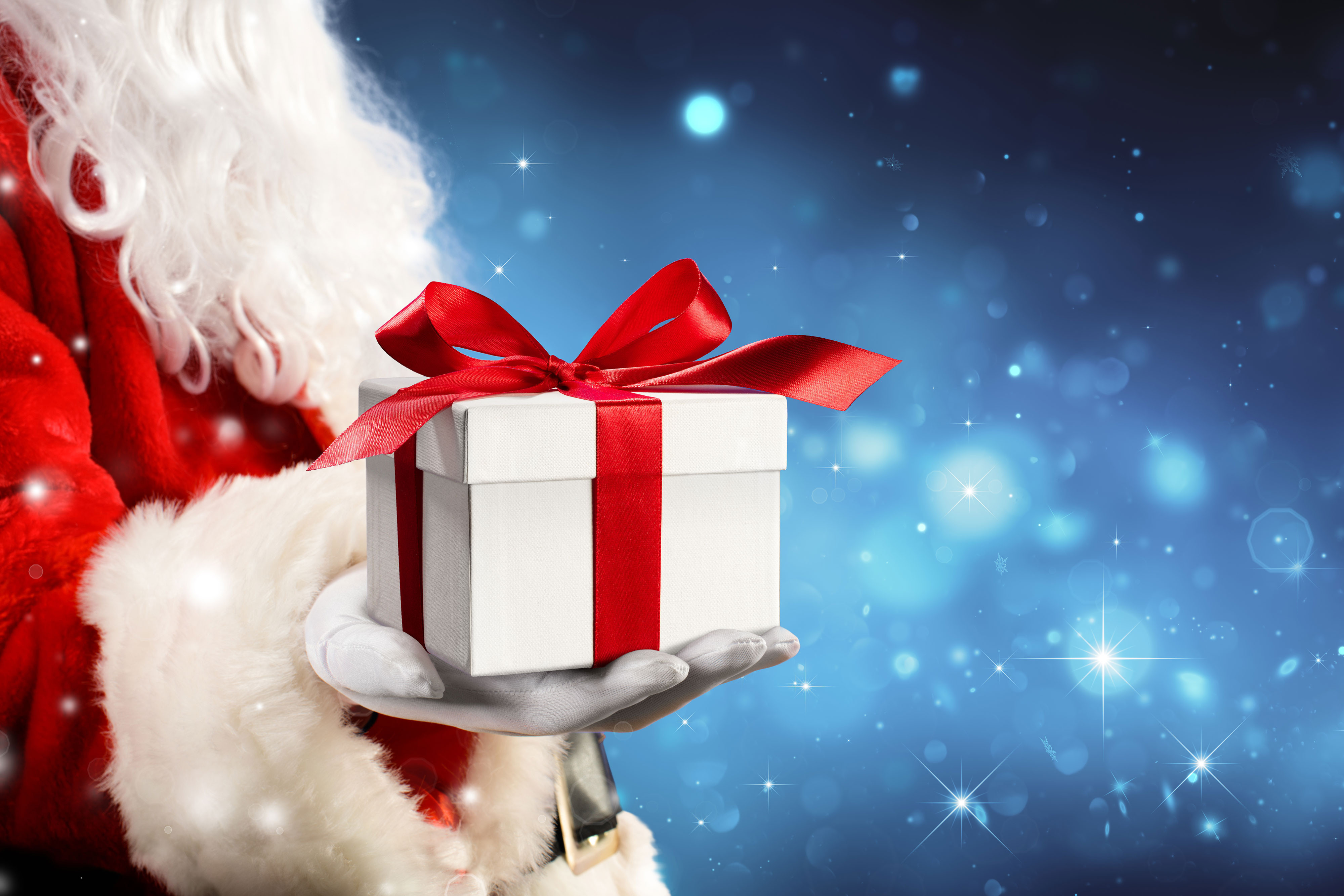 The Best Place For A Unique Holiday Party Near Orlando Florida | Santa holding gift