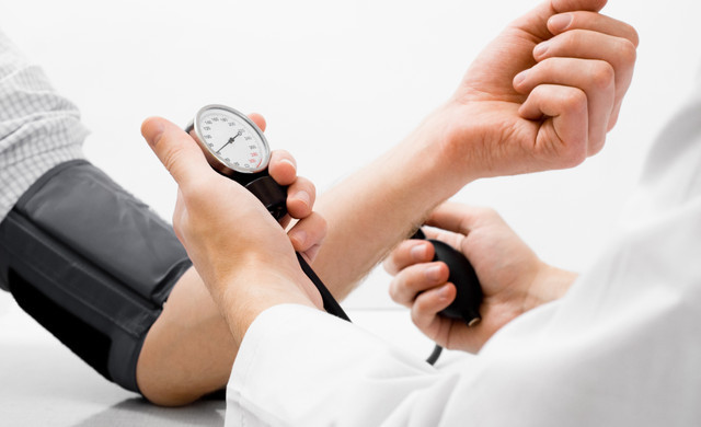 Doctor checking blood pressure - Westgate Resorts