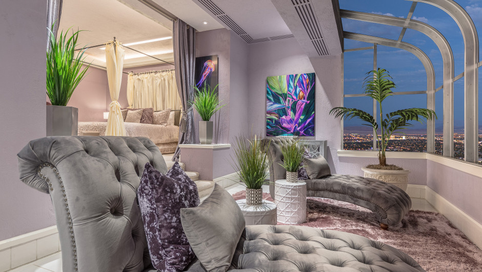 Bedroom with sitting area and city views in the Bahamas Suite - Westgate Las Vegas Resort & Casino