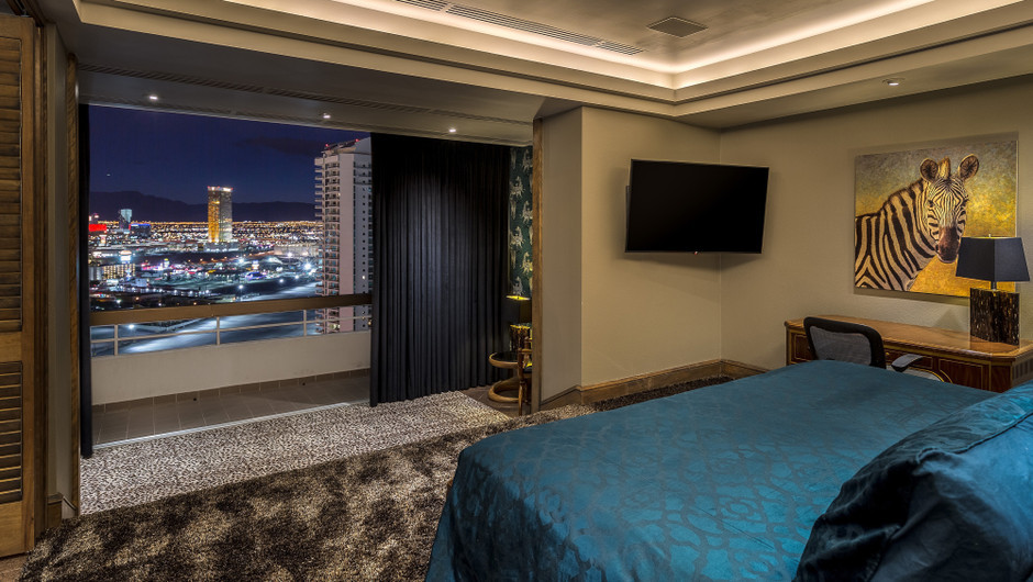 Bedroom with city views in the Gold Coast Suite - Westgate Las Vegas Resort & Casino