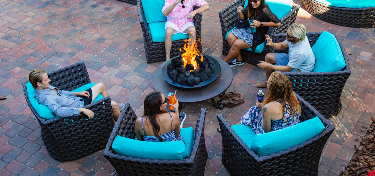 Taking a break from the beach and water park? Enjoy fresh air around a hot rock firepit, cozy up in comfy rattan lounge chairs with cocktails.