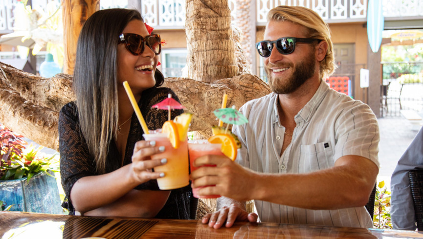 Couple Cheersing Tropical Drinks