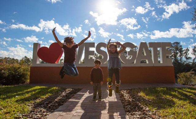 Kids jumping in front of I love Westgate sign | Westgate Leisure Resort