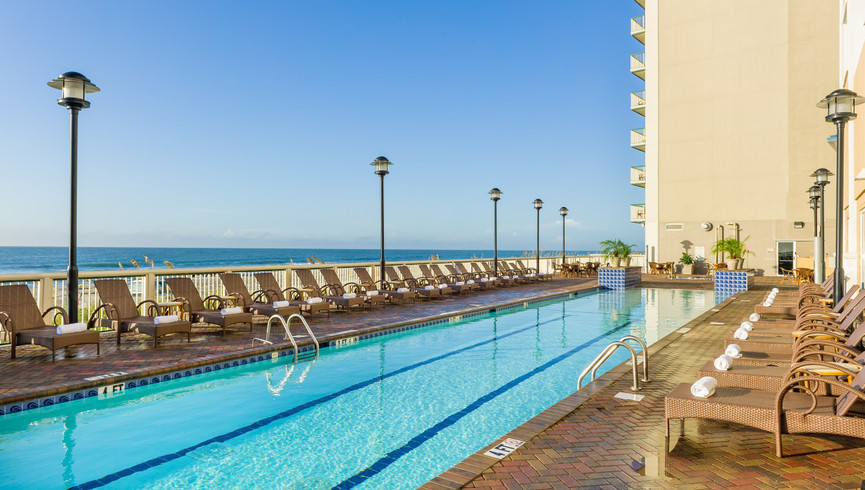 Heated outdoor pool, lazy river, water play area, oceanfront lap pool at a resort hotel in Myrtle Beach