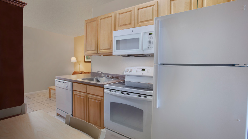 Kitchen with fridge, stove, microwave and sink - Harbour Beach Resort