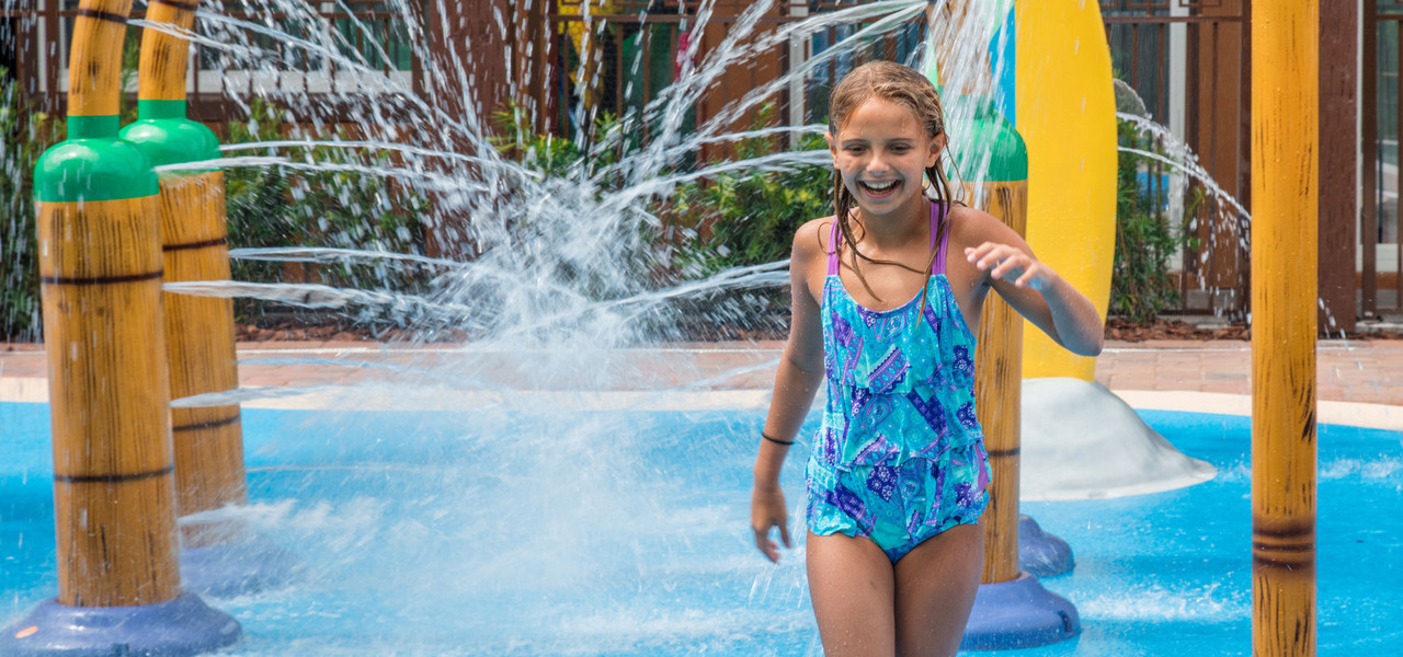 Water Parks Resort in Florida at our Hotel near Cocoa Beach | Water Park Girl Smiling