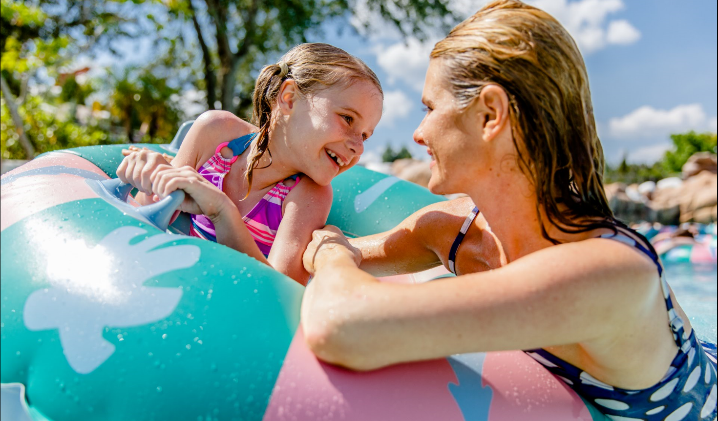 Woman and a little girl floating in a raft in Melt Away Bay at Disney's Blizzard Beach
