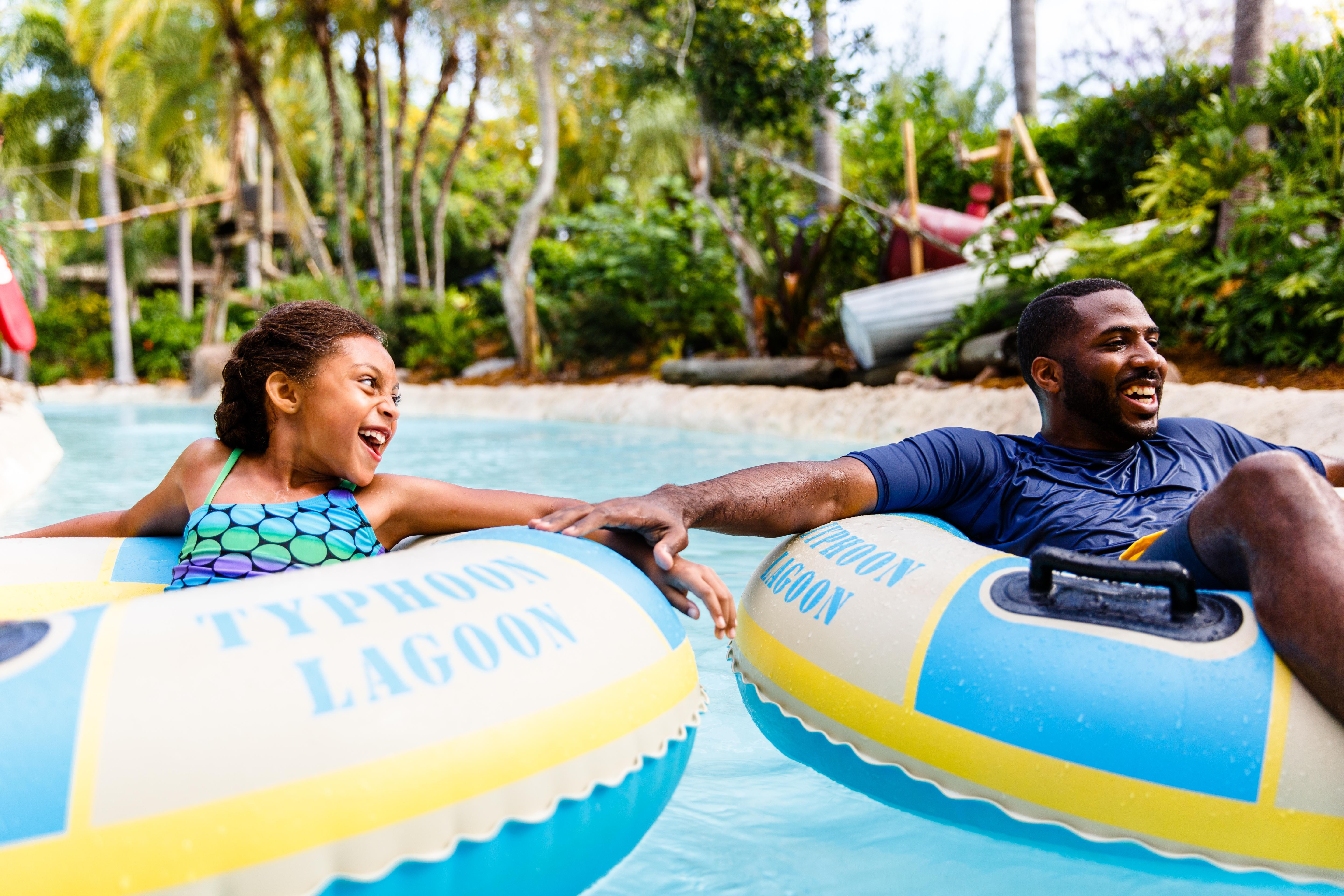 Father and daughter floating down Castway Creek together at Disney's Typhoon Lagoon