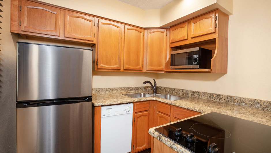 Kitchen in our Lodge One-Bedroom Cottage |  Westgate River Ranch Resort & Rodeo | Westgate Resorts