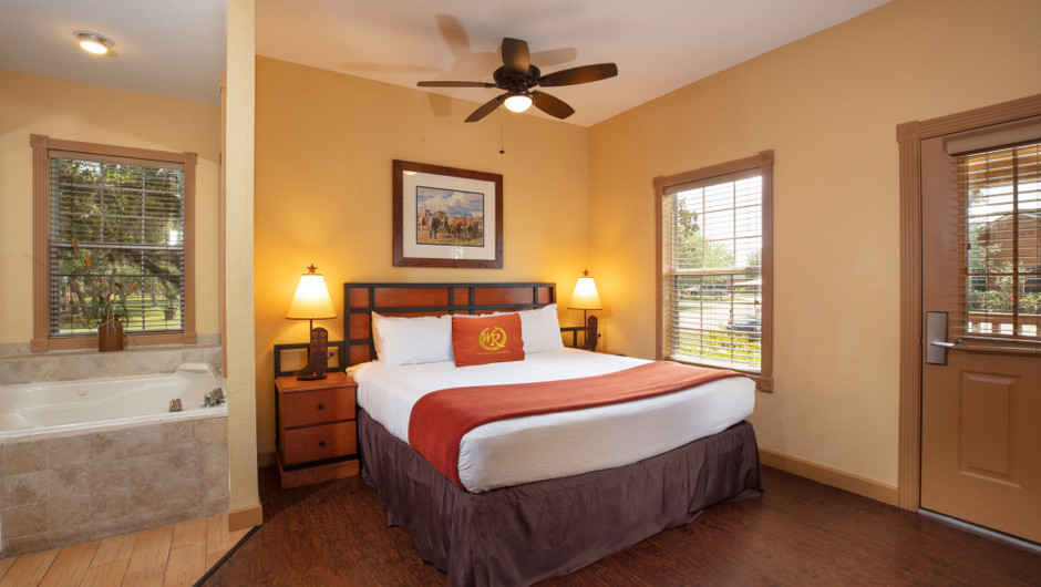 Bedroom in our Saddle Club One-Bedroom Grand Cabin |  Westgate River Ranch Resort & Rodeo | Westgate Resorts