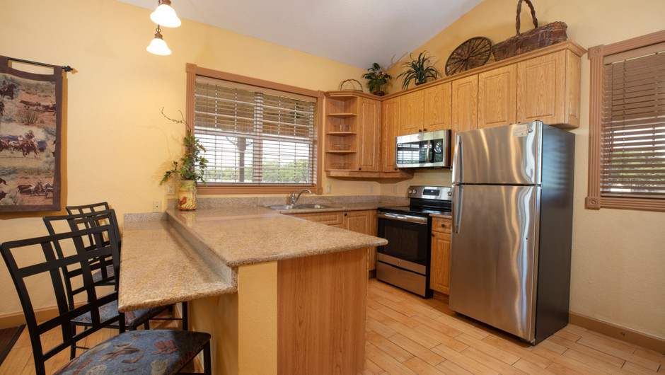 Kitchen in our Saddle Club One-Bedroom Grand Cabin |  Westgate River Ranch Resort & Rodeo | Westgate Resorts