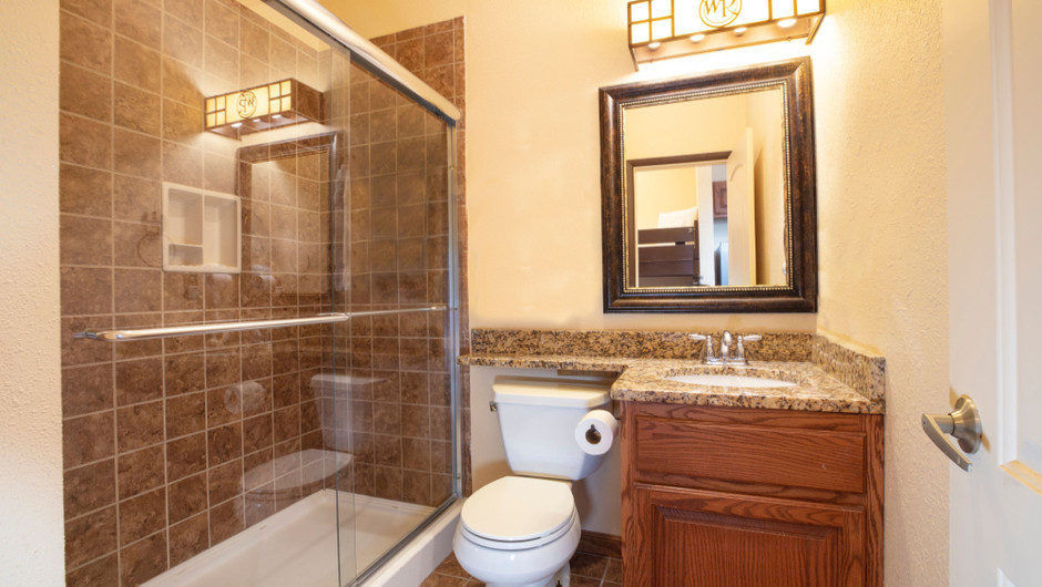 Bathroom in our Saddle Club Rail Car - Bedroom in the Saddle Club Rail Car - Westgate River Ranch Resort & Rodeo