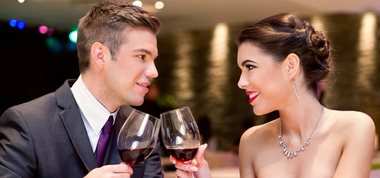 The Best Place For A Unique Holiday Party Near Orlando Florida | Couple drinking wine