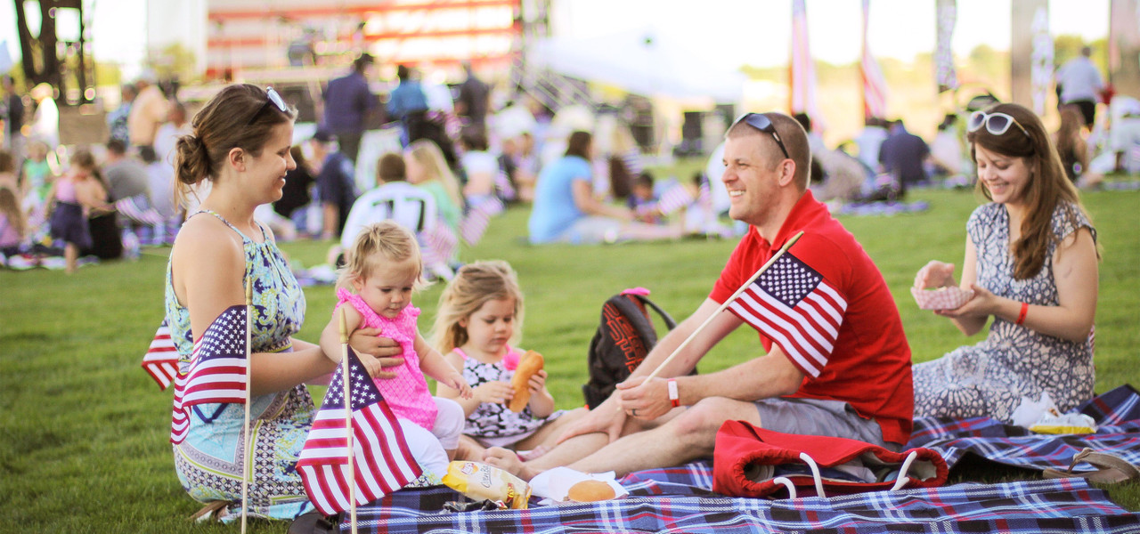 A Resort & Rodeo With Group Military Appreciation Rates | Family sitting on lawn