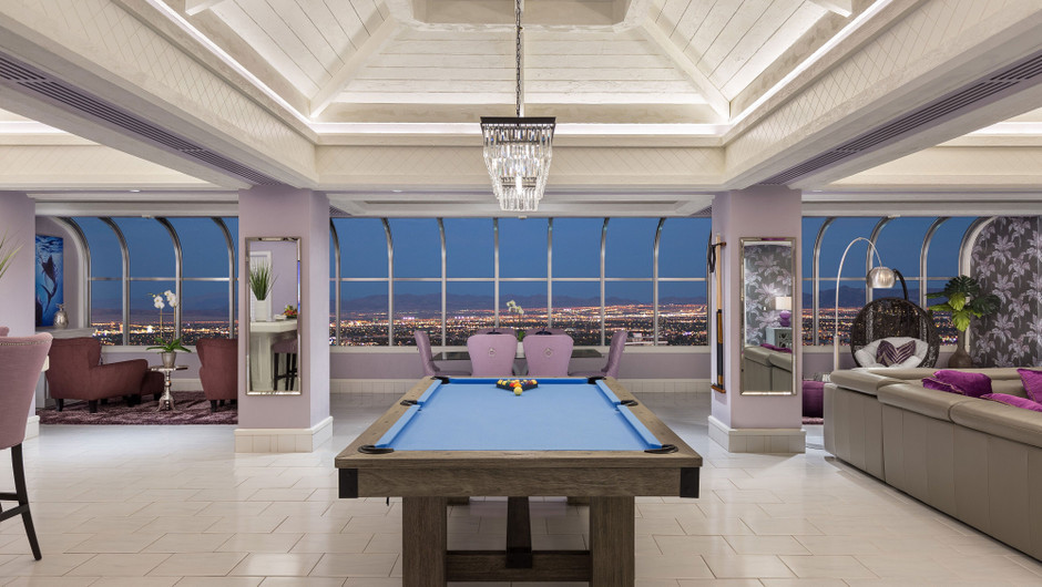 Living Area with billiards table and city views in the Bahamas Suite - Westgate Las Vegas Resort