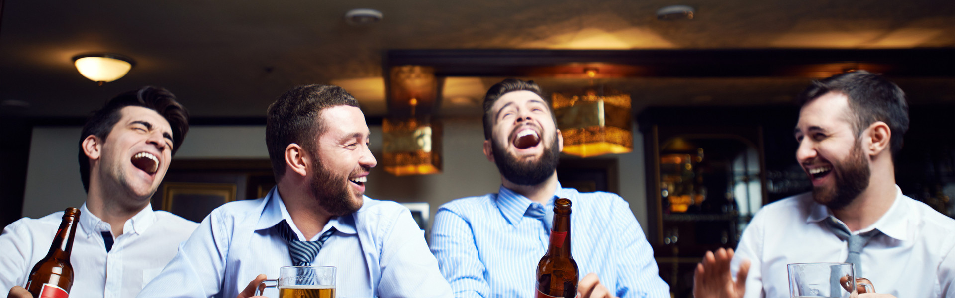 A Fraternity Formal Hotel In NYC | Group of guys celebrating with beers