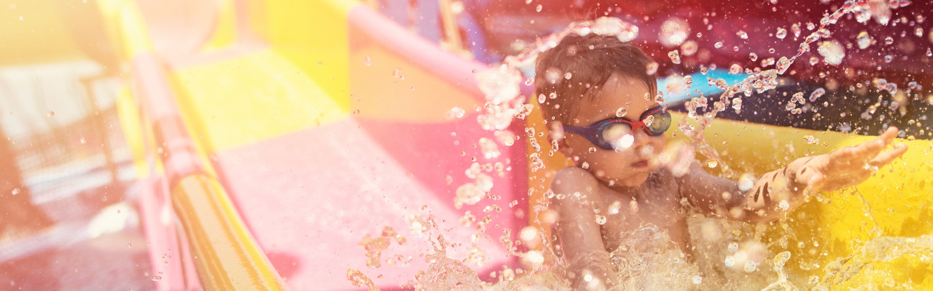 Kid splashing down at our new water park in Orlando, FL | Hotels With Water Parks in Orlando Florida | Westgate Lakes Resort & Spa