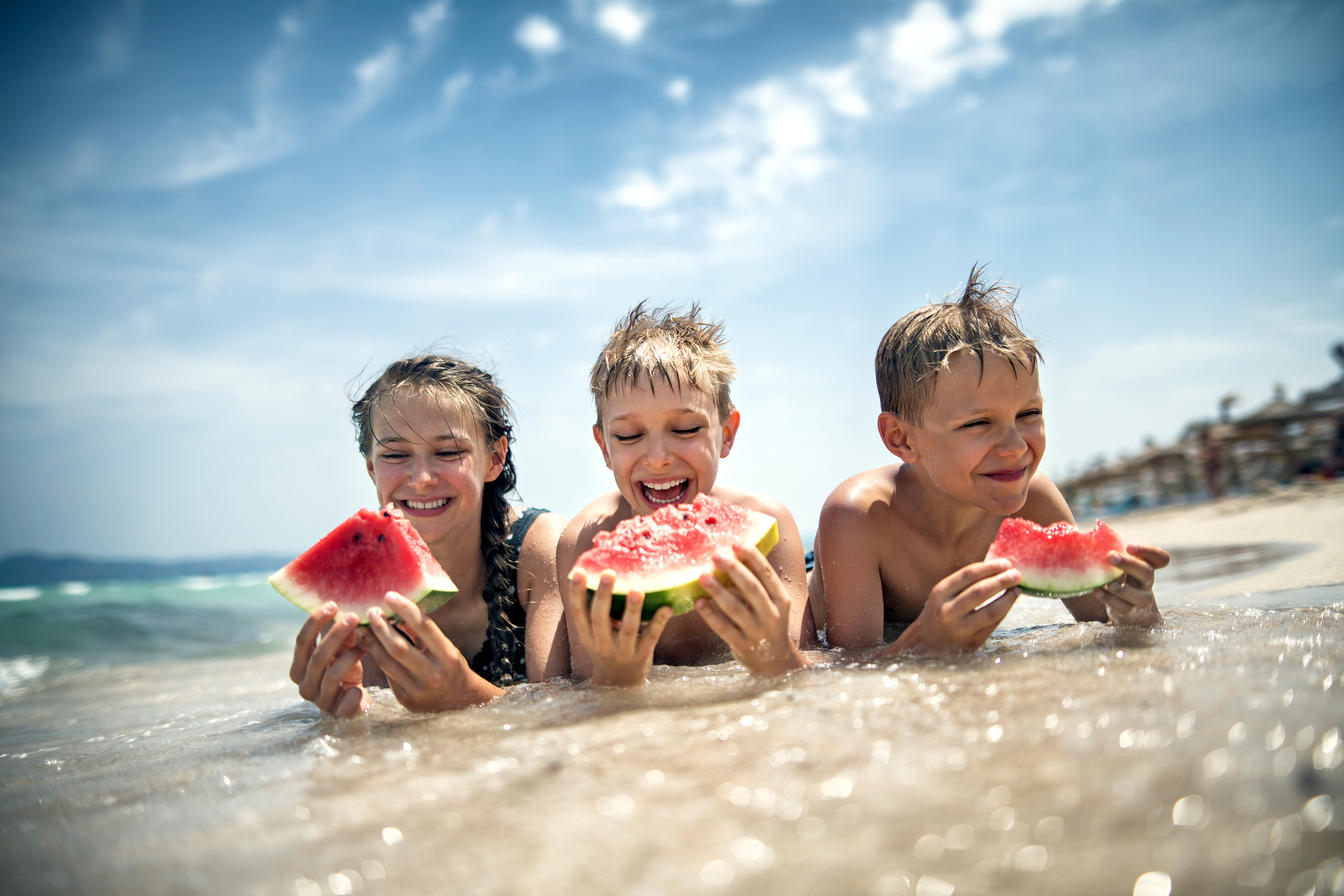 Children eating watermelon in the ocean - Westgate Resorts