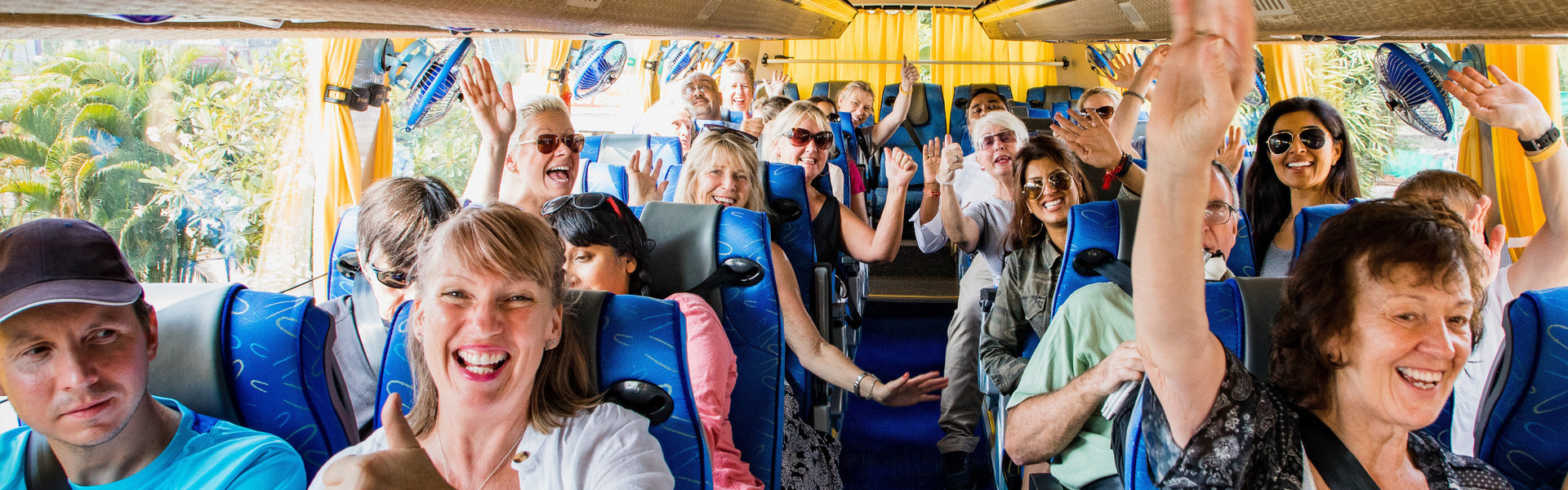 Team Building Activities In Orlando - Group on a bus ride