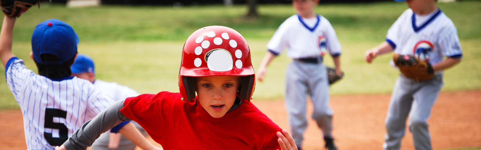 Sports Group Hotel Deals - baseball player running the bases