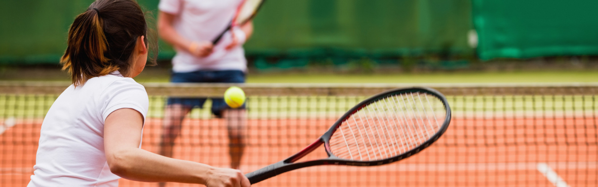 Couple playing tennis at the courts in Orlando Florida | Basketball & Tennis Courts | Westgate Lakes Resort & Spa
