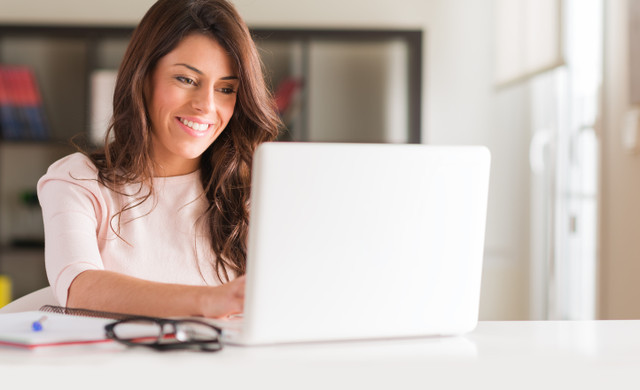 A woman on her laptop - Westgate Resorts