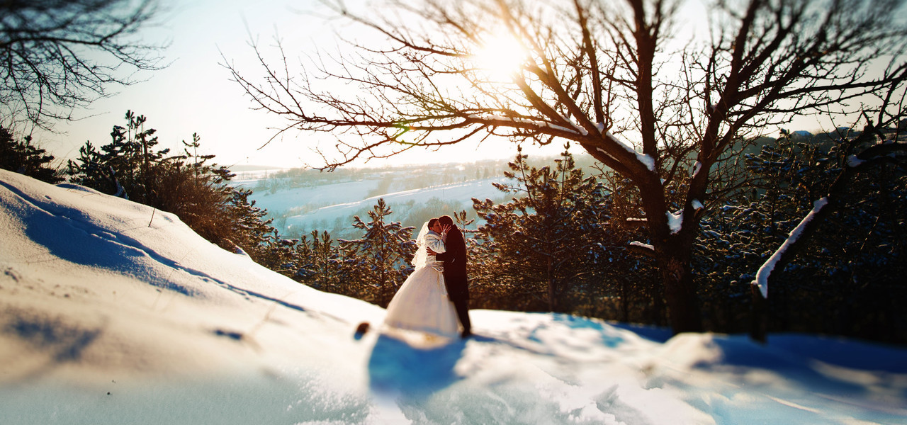 Park City Hotel Wedding Packages - newlyweds kissing with mountain backdrop