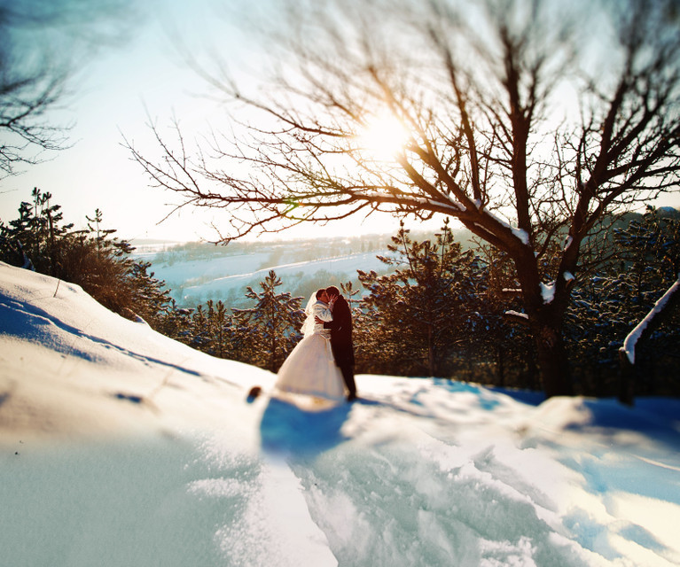 Park City Wedding Receptions - Couple kissing with mountain backdrop