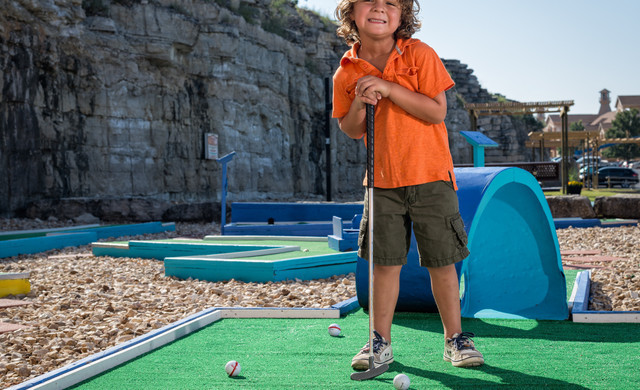 AAA Discount at our Branson Table Rock Lake Resort in Missouri   Kid Playing MIni Golf